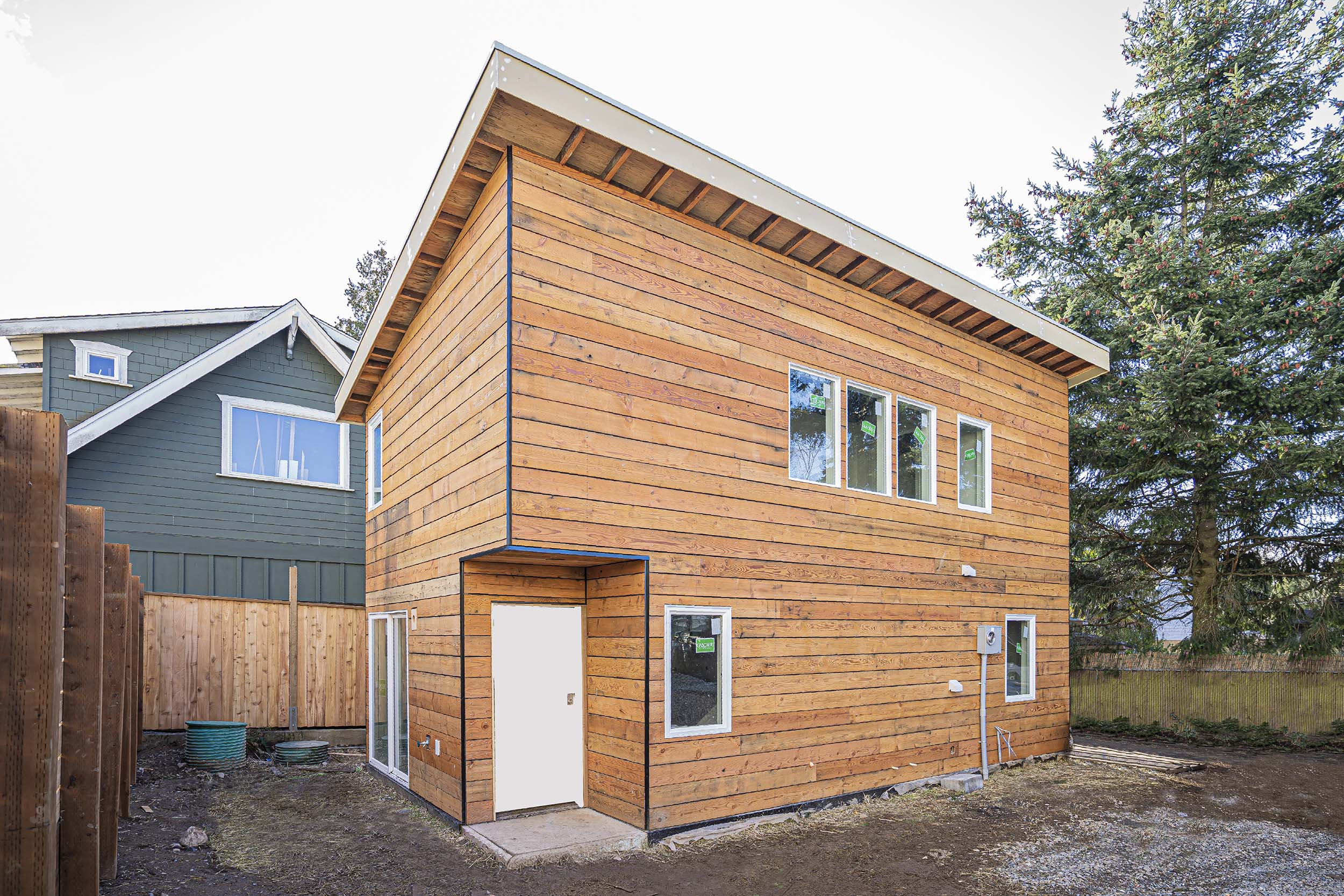 Custom design and construction of a two story DADU (Backyard Cottage) located at 10217 40th Ave SW, Seattle WA 98146